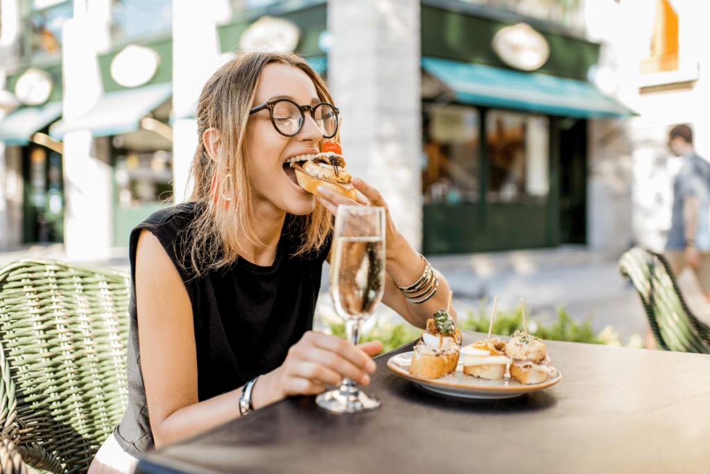 Lady eating tapas